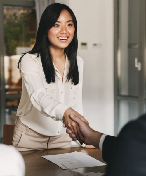 Candidate shaking hands after getting selected in the interview